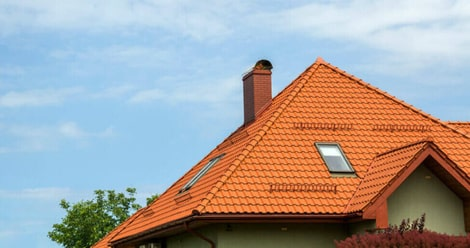 A Rochester home with a orange roof